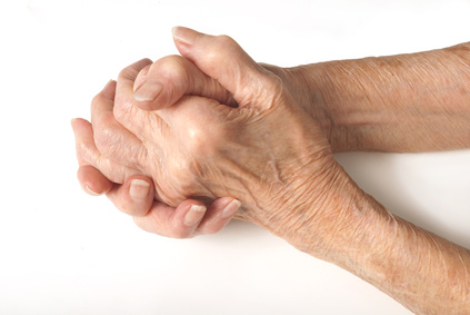 Aged hands clasped