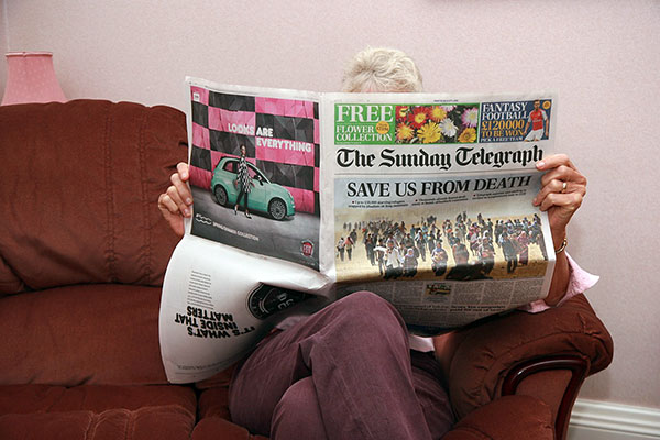 Perusing the newspapers